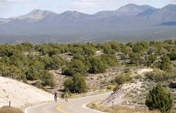 Bicyclists pedal a section of state highway in a mountainous part of Lincoln County, Saturday, Oct. 12, 2013