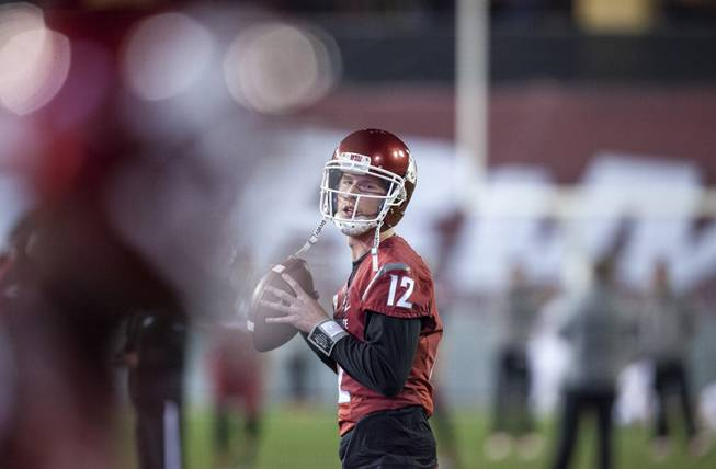 Washington State quarterback Connor Halliday (12) throws to a receiver during warmups before the start of an NCAA college football game against Oregon State on Saturday, Oct. 12, 2013, at Martin Stadium in Pullman, Wash. Oregon State won 52-24.