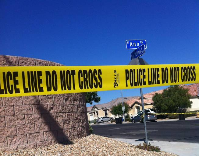 Police cordoned off a neighborhood in North Las Vegas near Ann Road and Via Victoria Street after a shooting and suicide Saturday, Oct. 12, 2013.
