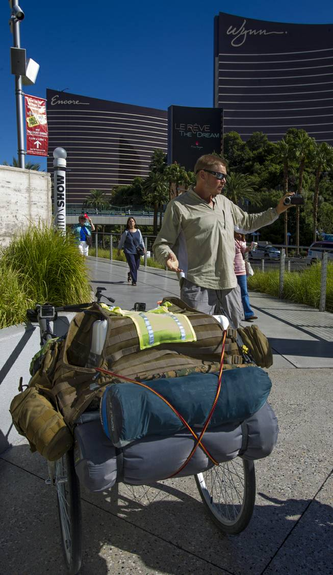 """The Walking Man"" Karl Bushby documents his walk along Las Vegas Boulevard South on Monday, Oct. 14, 2013, with his cart ""The Beast"" on his way to Caesars Palace for a three-day stay."