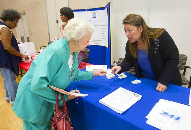 September LeMay, right, a certified information referral specialist, talks with Fran Drewrey, a member of the City of Las Vegas Senior Citizen's Advisory Board, about 2-1-1 during a senior safety fair at the East Las Vegas Community Center, 250 North Eastern Ave., Tuesday, Oct. 15, 2013. The 2-1-1 telephone number connects people with important community services and volunteer opportunities.