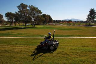 A worker mows some of the vast expanse of turf at the soon to open Craig Ranch Park in North Las Vegas Tuesday, October 15, 2013,