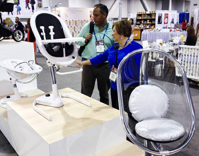 Mima, a Dutch company, introduced their Moon High Chair at the ABC Kids Expo at the Las Vegas Convention Center, Tuesday, Oct. 15, 2013.