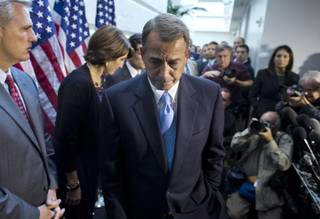 Speaker of the House Rep. John Boehner, R-Ohio, walks away from the microphone during a news conference after a House GOP meeting on Capitol Hill on Tuesday, Oct. 15, 2013 in Washington. The federal government remains partially shut down and faces a first-ever default between Oct. 17 and the end of the month.