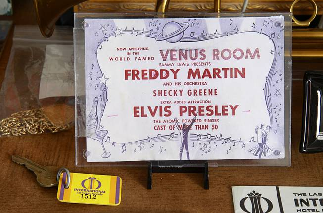 "A 1956 New Frontier promotional flier, part of Steve Cutler's collection of Las Vegas memorabilia, is shown at Cutler's home Wednesday, Oct. 16, 2013. The card advertises a show with Freddy Martin, Shecky Green and, as an added attraction, ""atomic-powered"" singer Elvis Presley."