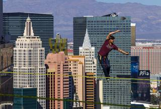 Daredevil slackline athlete Andy Lewis readies to attempt  the world record for the longest urban highline walk as Mickey Wilson (left) looks on outside the 63rd floor of Mandalay Bay Wednesday, Oct. 16, 2013.