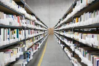 Rows of catalogued book are seen at the Goodwill Distribution Center at 1280 W. Cheyenne Ave. Monday, Oct. 16, 2013. Books are among the many items for sale by Goodwill in online marketplaces.