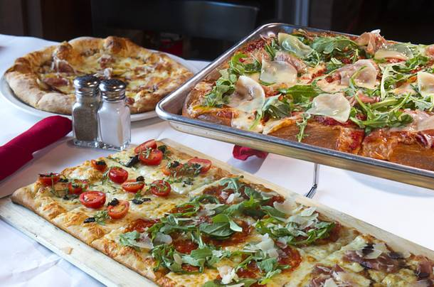 Pizzas, clockwise from top left, Cal Italia, Sicilian and a Roman, at the new Pizza Rock restaurant at Third Street and Ogden Avenue in downtown Las Vegas Thursday, Oct. 17 2013.