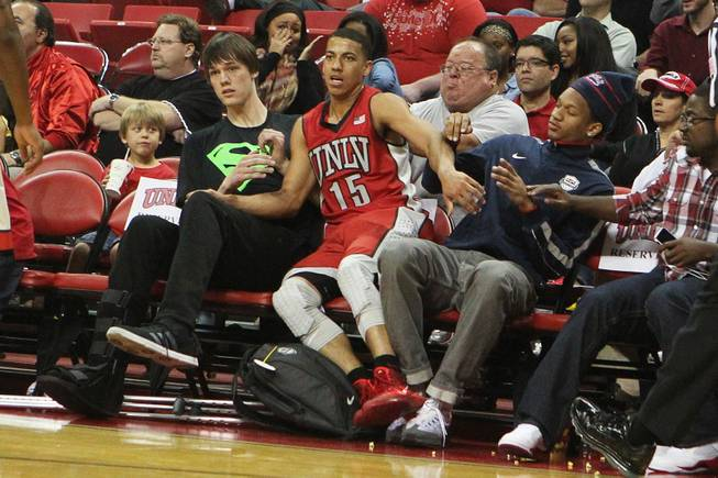 UNLV guard Kendall Smith falls into UNLV recruits Stephen Zimmerman, left, and Rashad Vaughn during their annual preseason Scarlet and Gray scrimmage Thursday, Oct. 17, 2013 at the Thomas & Mack.