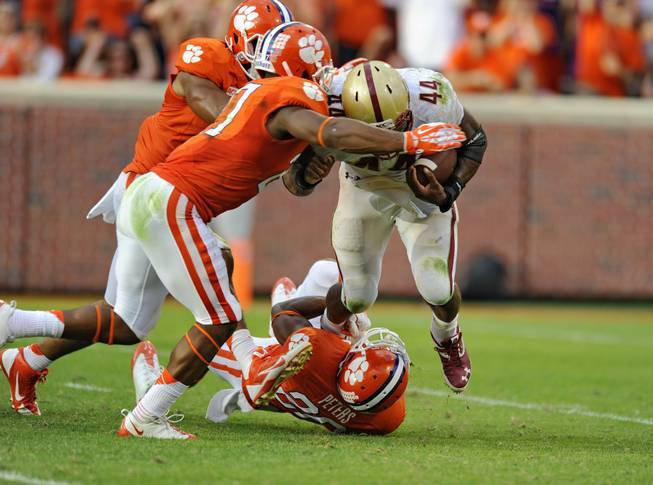 Clemson's Garry Peters (26), Robert Smith (27) and Vic Beasley stop Boston College's Andre Williams in the backfield during the second half of an NCAA college football game Saturday, Oct. 12, 2013, at Memorial Stadium in Clemson, S.C. Clemson won 24-14.
