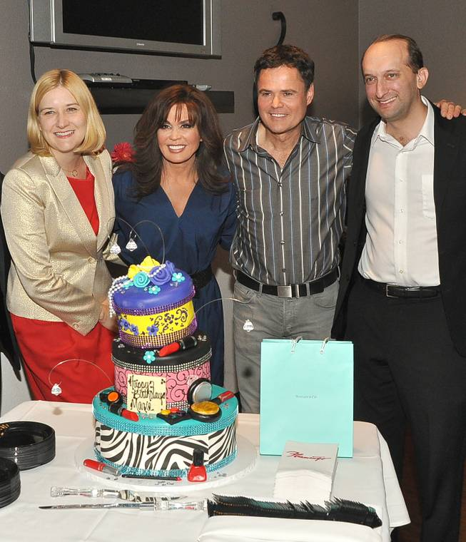 Flamingo Las Vegas Regional President Eileen Moore, Marie Osmond, Donny Osmond and and Caesars Entertainment Senior VP of Marketing and Entertainment Jason Gastwirth celebrate Marie's 54th birthday at the Flamingo on Tuesday, Oct. 15, 2013. Marie turned 54 on Sunday.