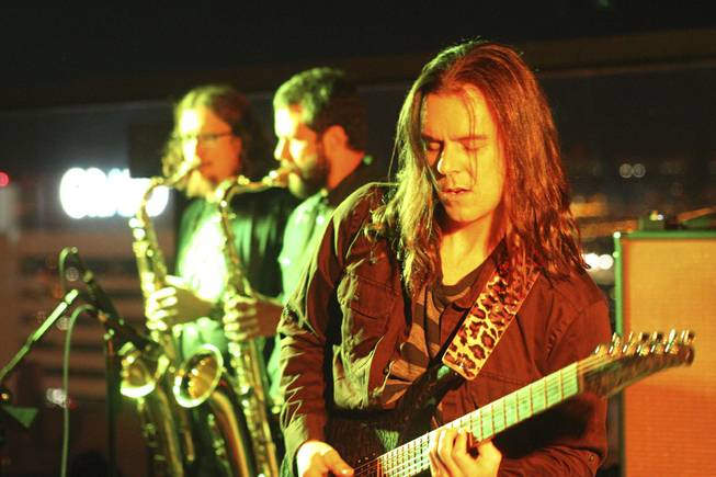 "Guitarist Jeremy Parks, right, of local band Moksha during their set at the ""Rooftop Fall Ball 3"" on the Binion's Gambling Hall & Hotel rooftop pool deck, Friday, Oct. 18, 2013."