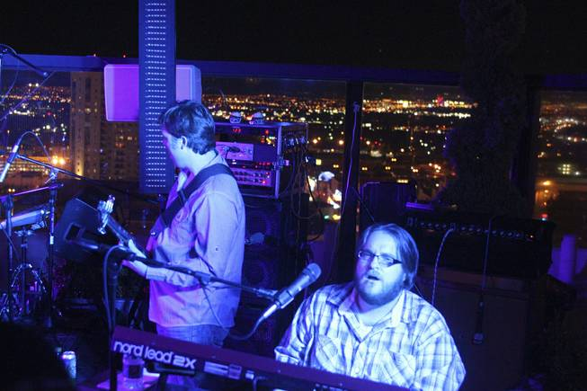 "Moksha band members John Heishman, left, on bass and Brian Triola, right, during their set at the ""Rooftop Fall Ball 3"" on the Binion's Gambling Hall & Hotel rooftop pool deck, Friday, Oct. 18, 2013."