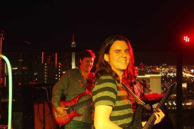 "Bassist John Heishman, back, and guitarist Jeremy Parks, front, of local band Moksha during their set at the ""Rooftop Fall Ball 3"" on the Binion's Gambling Hall & Hotel rooftop pool deck, Friday, Oct. 18, 2013."
