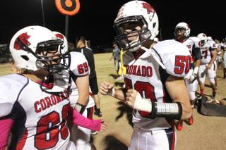 Coronado's Anthony Mollinedo, left, and Ryan Everette celebrate in the closing seconds of their game against Foothill Friday, Oct. 18, 2013. Coronado won the game 34-25.