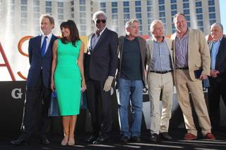 The cast of the film Last Vegas, from left, Kevin Kline, Mary Steenburgen, Morgan Freeman, Robert De Niro, Michael Douglas and director Jon Turteltaub, pose for photos after receiving honors from Las Vegas and Clark County Friday, Oct. 18, 2013 in front of the Bellagio.