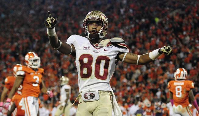 Florida State wide receiver Rashad Greene (80) celebrates after scoring a touchdown against the Clemson during the second half of an NCAA college football game, Saturday, Oct. 19, 2013, in Clemson, S.C.