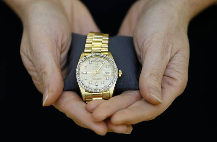 A Christie's specialist displays a Rolex watch given to Elvis Presley by his manager for Christmas in 1976, during a photocall at the auction rooms in London, Friday, Nov. 23, 2012. The watch estimated at 6,000- 8,000 pounds (9,500- 12,750 US Dollars) will go on sale in the Pop Culture auction on Nov. 29 in London.