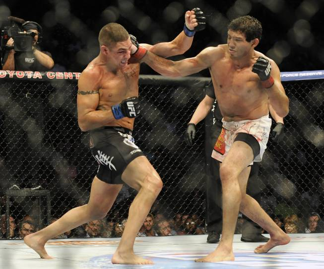 Gilbert Melendez, right, and Diego Sanchez fight in the second round of a UFC lightweight bout in Houston, Saturday, Oct. 19, 2013. Menendez won in a unanimous decision. (AP Photo/Pat Sullivan)