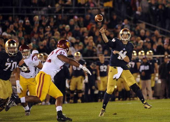 Notre Dame quarterback Tommy Rees throws a pass in a NCAA college football game with Southern California Saturday Oct. 19, 2013 in South Bend, Ind.