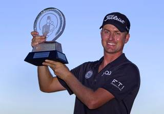 Webb Simpson of Charlotte, N.C. poses with his trophy after winning the Shriners Hospitals for Children Open at TPC Summerlin Sunday Oct. 20, 2013.