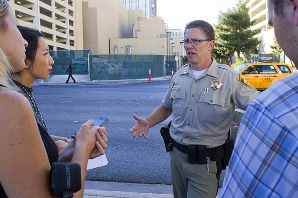 Metro Police Capt. Robert DuVall responds to questions from reporters after a Planet Hollywood employee discovered a dead baby in a trash bin outside the hotel Monday, Oct. 21, 2013.