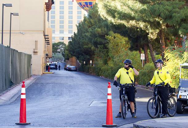 Hotel security officers guard an access road behind Planet Hollywood  after an employee discovered a dead baby in a trash bin outside the hotel Monday, Oct. 21, 2013.