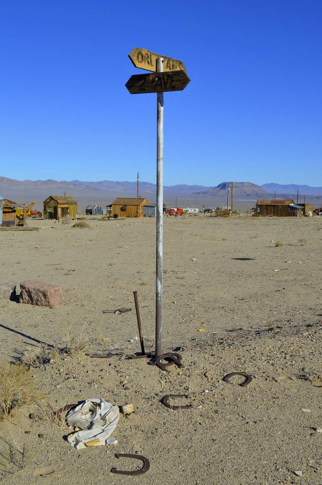 A street corner features horseshoes in Gold Point, which is south of Goldfield, NV, Tuesday, Oct. 22, 2013. The town has 10 year-round residents, if you count three who live outside of what's considered town limits.