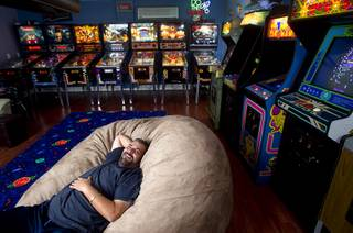 Pinball repairman Craig Snelling relaxes in the game room of his Henderson home Tuesday, Oct. 22, 2013. Snelling is a pinball machine repairman and owner of Billiards 'N More, a billiards and game room supply store.