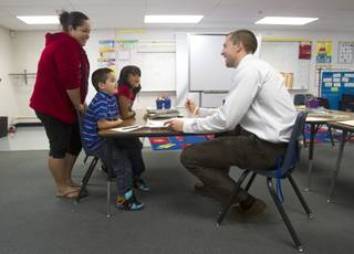 First grade teacher Charlie Lockwood talks with his student Angel Rosales, his mother Fabiola and his sister Marisol during a parent-teacher conference at Lois Craig Elementary School in North Las Vegas Wednesday, Oct. 23, 2013.