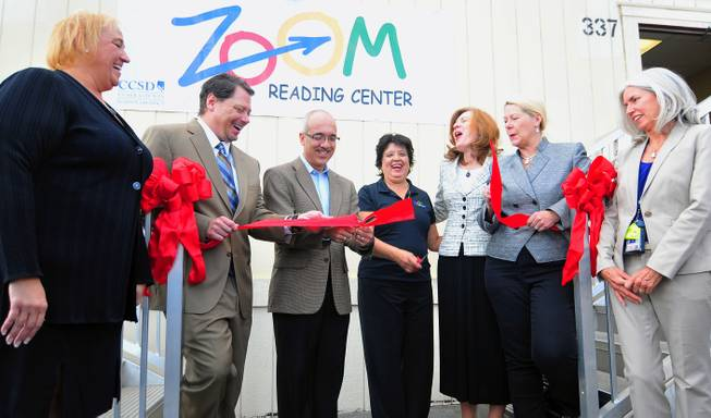 "Nevada Senate Majority Leader Mo Denis cuts a ribbon to a ""Zoom"" Reading Center on Wednesday, October 23, 2013, at Lunt Elementary School. From left to right: Clark County Schools Superintendent Pat Skorkowsky, Lunt Principal Thelma Davis, Academic Manager Danielle Miller, UNLV law professor Sylvia Lazos, School Board members Lorraine Alderman and Patrice Tew and State Senator Mo Denis."