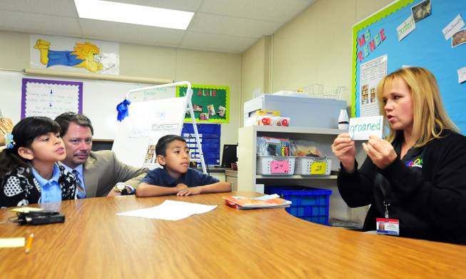 A reading tutor works with English-language learner students as Clark County Schools Superintendent Pat Skorkowsky looks on at a Zoom Reading Center on Wednesday, October 23, 2013, at Lunt Elementary School.