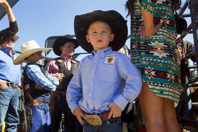 Blayne Shivers, 6, son of professional bull rider Chris Shivers, waits for the start of the Chris Shivers Miniature Bull Riding (MBR) World Finals at Mandalay Bay Thursday, Oct. 24, 2013. Blayne competed in the Mutton Busting. The MBR features junior riders ages 8 to11 and senior riders ages 12 to 14. The event was part of the the 2013 Professional Bull Riders Built Ford Tough World Finals.