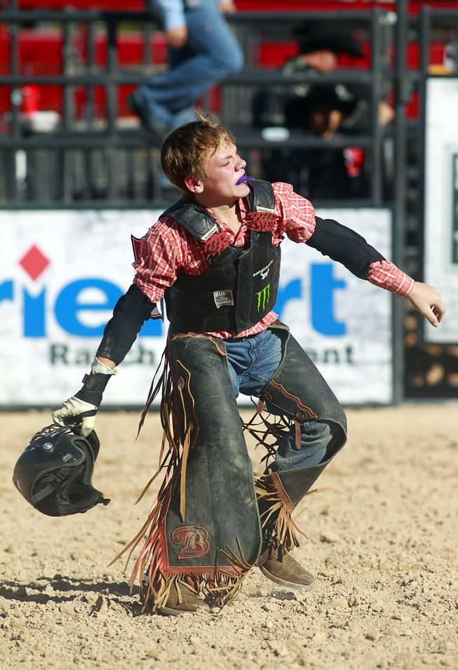Senior rider Hunter Ray of Kolin. La. celebrates a successful ride during the Chris Shivers Miniature Bull Riding (MBR) World Finals at Mandalay Bay Thursday, Oct. 24, 2013. The MBR features junior riders ages 8 to11 and senior riders ages 12 to 14. The event was part of the the 2013 Professional Bull Riders Built Ford Tough World Finals.