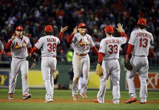 The St. Louis Cardinals celebrate after defeating the Boston Red Sox, 4-2, in Game 2 of baseball's World Series Thursday, Oct. 24, 2013, in Boston. The series is at 1-1. (AP Photo/Matt Slocum)