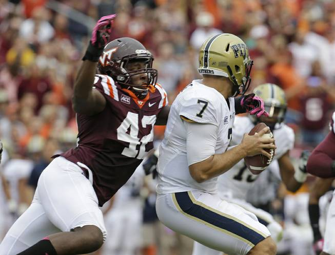 Virginia Tech defensive end J.R. Collins (42) pressures Pittsburgh quarterback Tom Savage (7) during the first half of an NCAA college football game in Blacksburg, Va., Saturday, Oct. 12, 2013.