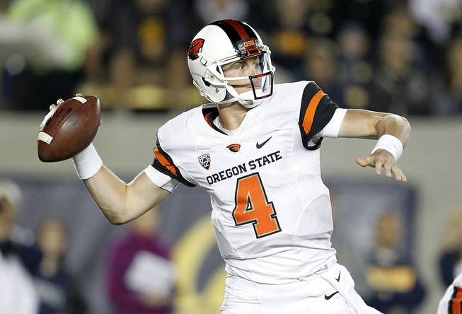 Oregon State quarterback Sean Mannion (4) throws a pass against California during the first quarter of an NCAA college football game in Berkeley, Calif., Saturday, Oct. 19, 2013. (AP Photo/Tony Avelar)