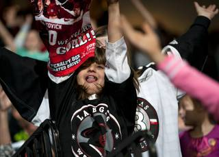 A young Wranglers fan dances to the music during a stoppage in play between Las Vegas and the Alaska Aces on Friday night at the Orleans Arena.