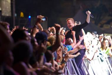 Dan Reynolds of Imagine Dragons interacts with fans during day one of the Life is Beautiful festival in downtown Las Vegas, Saturday, Oct. 26, 2013.
