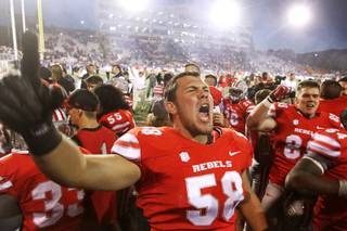 UNLV lineman Brian Roth celebrates the Rebels 27-22 victory over UNR Saturday, Oct. 26, 2013 at Mackay Stadium in Reno.