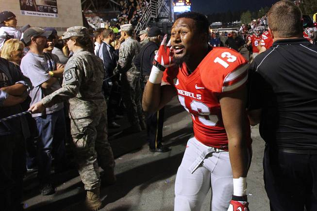 "UNLV senior linebacker Eric Tuiloma-Vaa asks UNR fans ""Who do I hear crying,"" after the Rebels beat the Wolf Pack 27-22 Saturday, Oct. 26, 2013 at Mackay Stadium in Reno."