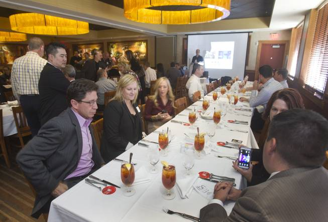 Businesspeople attend a networking luncheon sponsored by the Technology Business Alliance of Nevada at Fogo de Chao. Many expert networkers say they enjoy meeting over meals because of the intimacy a dining table creates. Others, however, say such a setting is confining.
