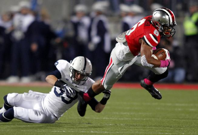 Ohio State receiver Evan Spencer, right, tries to get past Penn State safety Jesse Della Valle during an NCAA college football game Saturday, Oct. 26, 2013, in Columbus, Ohio. Ohio State beat Penn State 63-14.