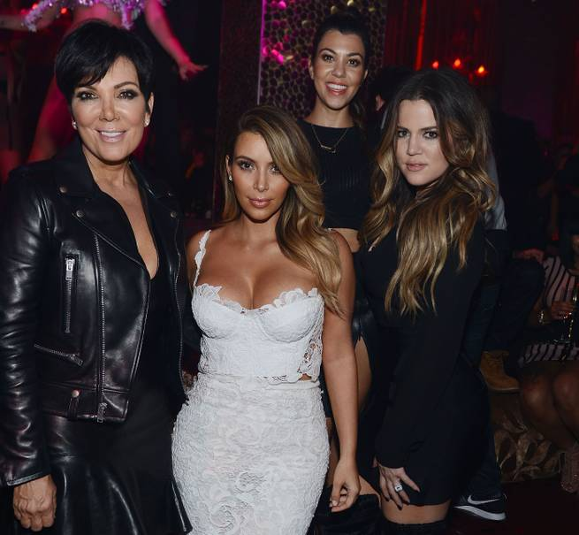 Kim Kardashian, second from left, celebrates her 33rd birthday with Kris Jenner, Kourtney Kardashian and Khloe Kardashian Odom on Friday, Oct. 25, 2013, at Tao in the Venetian.