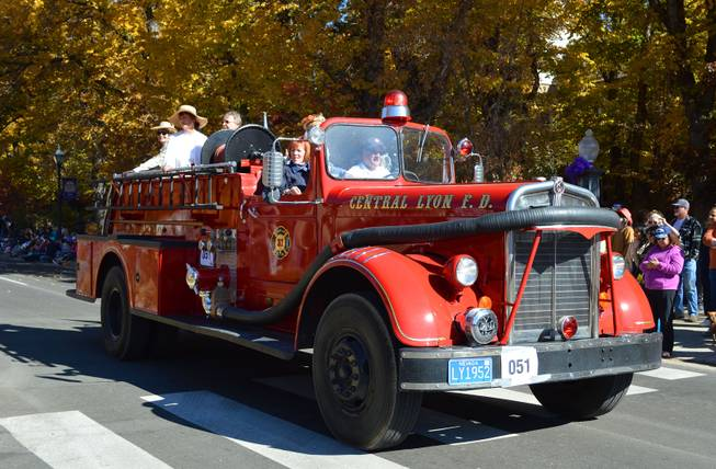 A truck representing the Central Lyon County Fire Protection District drives in the annual Nevada Day parade in Carson City on Oct. 26, 2013.