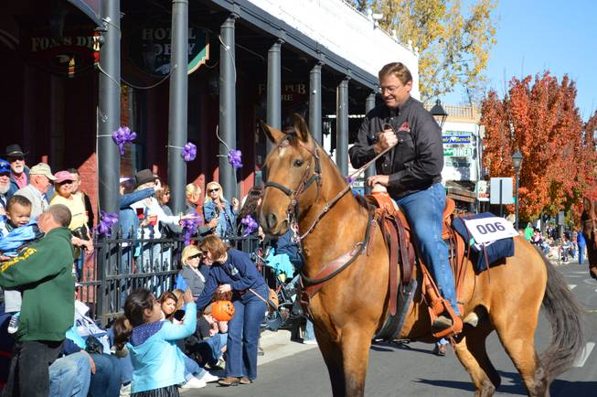 U.S. Sen. Dean Heller, R-Nev., reins in his horse during the Nevada Day parade in Carson City on Saturday, Oct. 26, 2013.