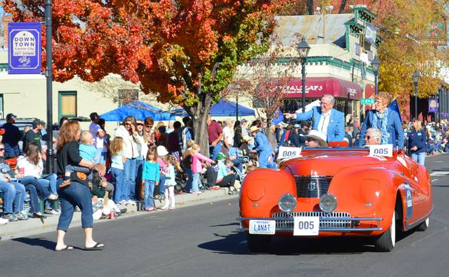 Mike Shaughnessy, the grand marshal of the Nevada Day parade, points as he rides along Carson Avenue on Saturday, Oct. 26, 2013. Shaughnessy was in the first Nevada Day parade 75 years ago as a 3-year-old dressed as Daniel Boone.