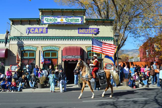 People line Carson Avenue in Carson City on Saturday, Oct. 26, 2013, for the 75th annual Nevada Day parade.