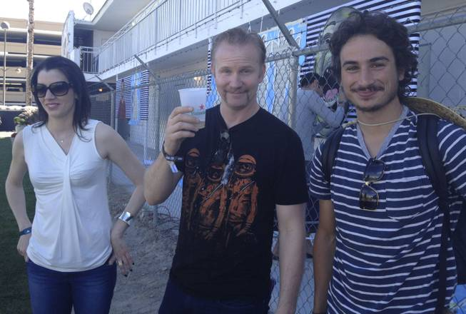 Artist Zio Ziegler, right, stands with documentary filmmaker Morgan Spurlock outside the art installation Art Odyssey at the Life is Beautiful festival on Saturday, Oct. 26, 2013.