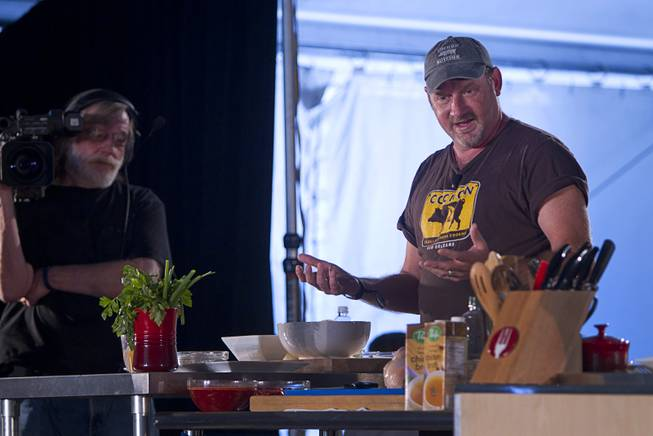 Chef Donald Link creates a meal on the East Stage during the Life is Beautiful Festival in downtown Las Vegas Sunday, Oct. 27, 2012.
